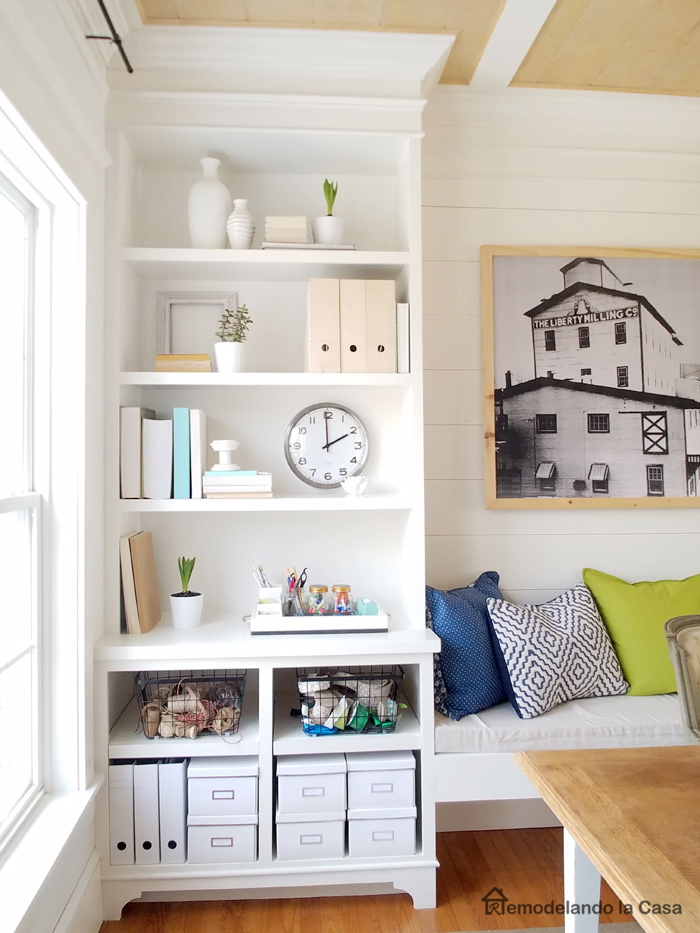 ikea storage boxes, big clock and wire baskets on built-ins