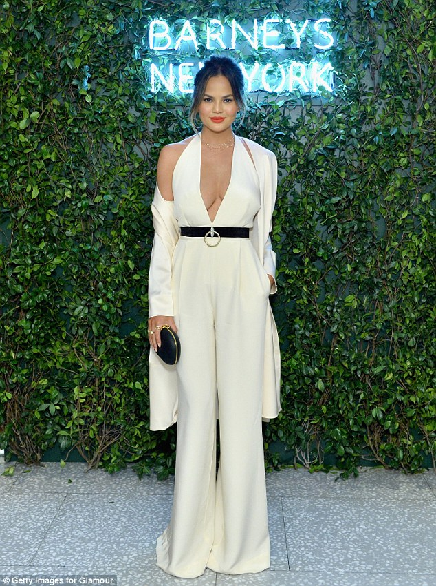 Chrissy Teigen oozes sex appeal in low-cut jumpsuit at fashion dinner in LA