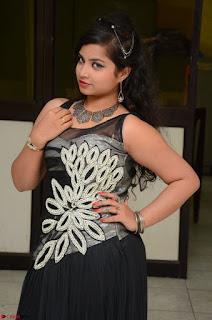 Shrisha Dasari in Sleeveless Short Black Dress At Follow Follow U Audio Launch 084.JPG