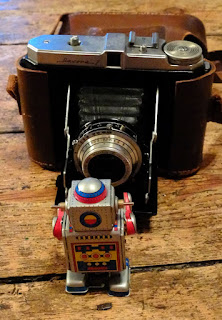 A toy robot with a dacora 1 camera