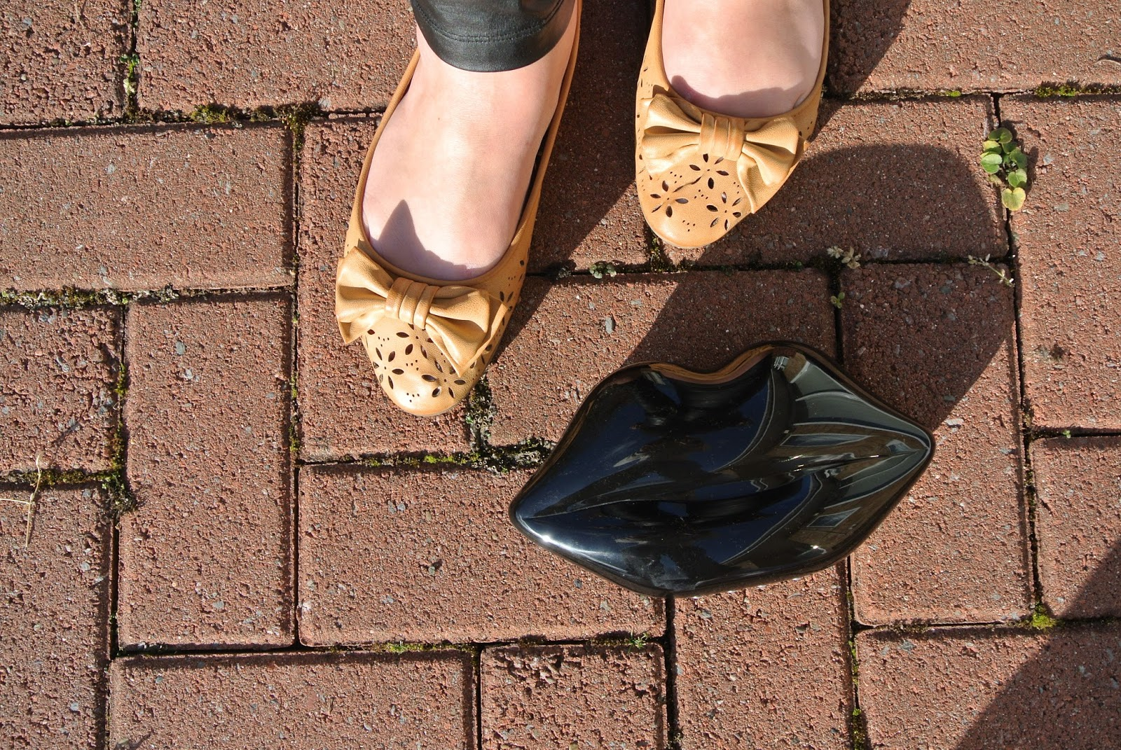 Tan shoes with bow and black lulu guinness lips clutch