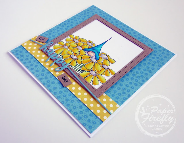 Handcrafted card with gnome among flowers (image is Gnome Bouquet from Stamping Bella)