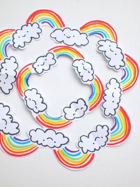 Cut rainbow snowflakes - A fun kirigami-esque craft that rainbow-loving kids are sure to enjoy