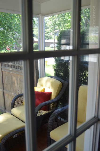 View of summer porch through a window pane from inside the house