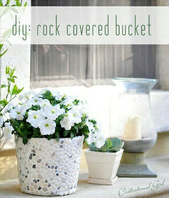 Vas bunga dari kaleng bekas yang dilapisi kerikil