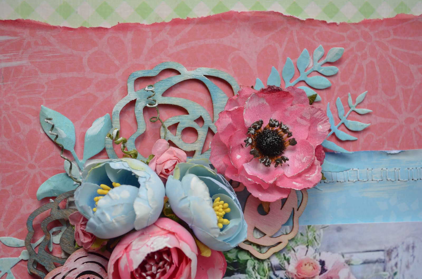 Scrapbooking layout in pink, green, and blue with lots of flowers, wood embellishments, and corrugated cardboard.