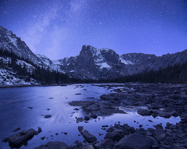Notchtop Mountain in Rocky Mountain National Park Colorado at night with the Milky Way at Two Rivers Lake