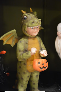 child dressed as a dragon for Halloween, collectible figure from Shelley B Home and Holiday