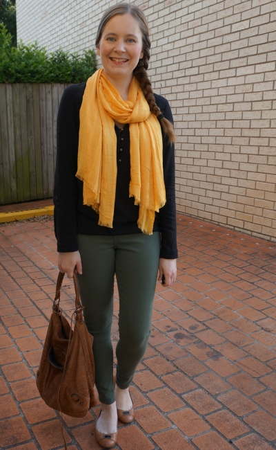 mustard scarf with black blouse and olie jeans balenciaga day bag | away from the blue