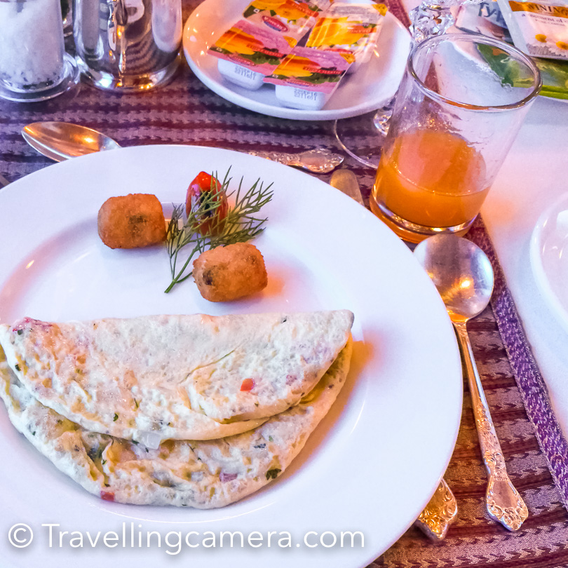 Breakfast menu included cut fruit, Mango/Pineapple/Orange juices, cornflakes, wheat flakes, Muesli, oatmeal, cheese, eggs accompanied by ham, bacon, chicken sausages, grilled potatoes, masala dosa, aloo parantha, fresh breads and beverages.