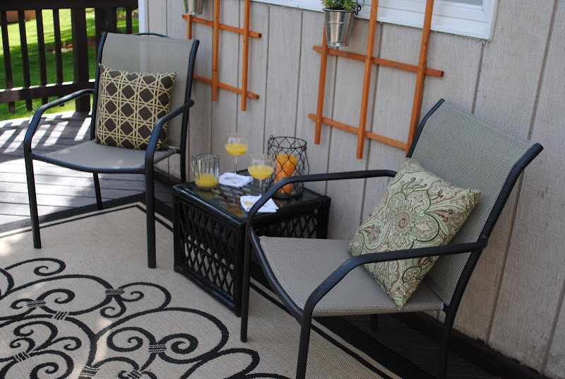 Seating area on the back deck with a trellis