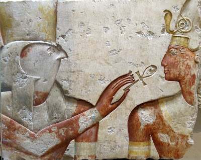 Horus holding the ankh at the nose of the pharaoh Ramses, Abydos, Egypt