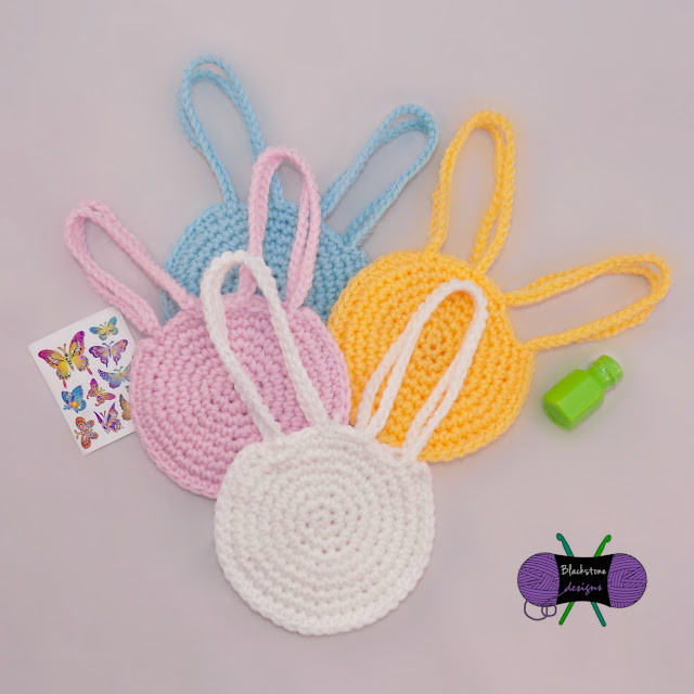 http://www.ravelry.com/patterns/library/bunny-head-treat-bag