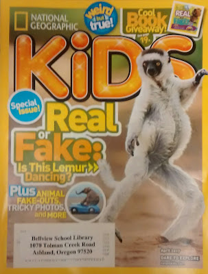 Cover, April 2017 issue of National Geographic Kids. Image depicts lemur standing on hind legs, arms upraised. Caption reads, 'Real or Fake: Is this Lemur Dancing?' Additional text next to insert-photo of elephant sitting on top of car, reads: 'Plus: Animal Fake-Outs, Tricky Photos, and More'