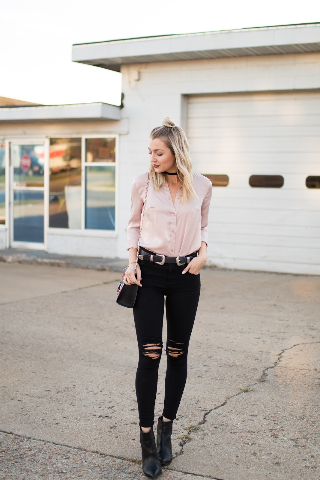 Satin/silky top with ripped skinny jeans a belt