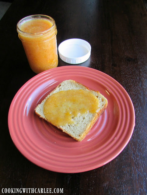 vanilla peach preserves spread over toast with jar of preserves in background
