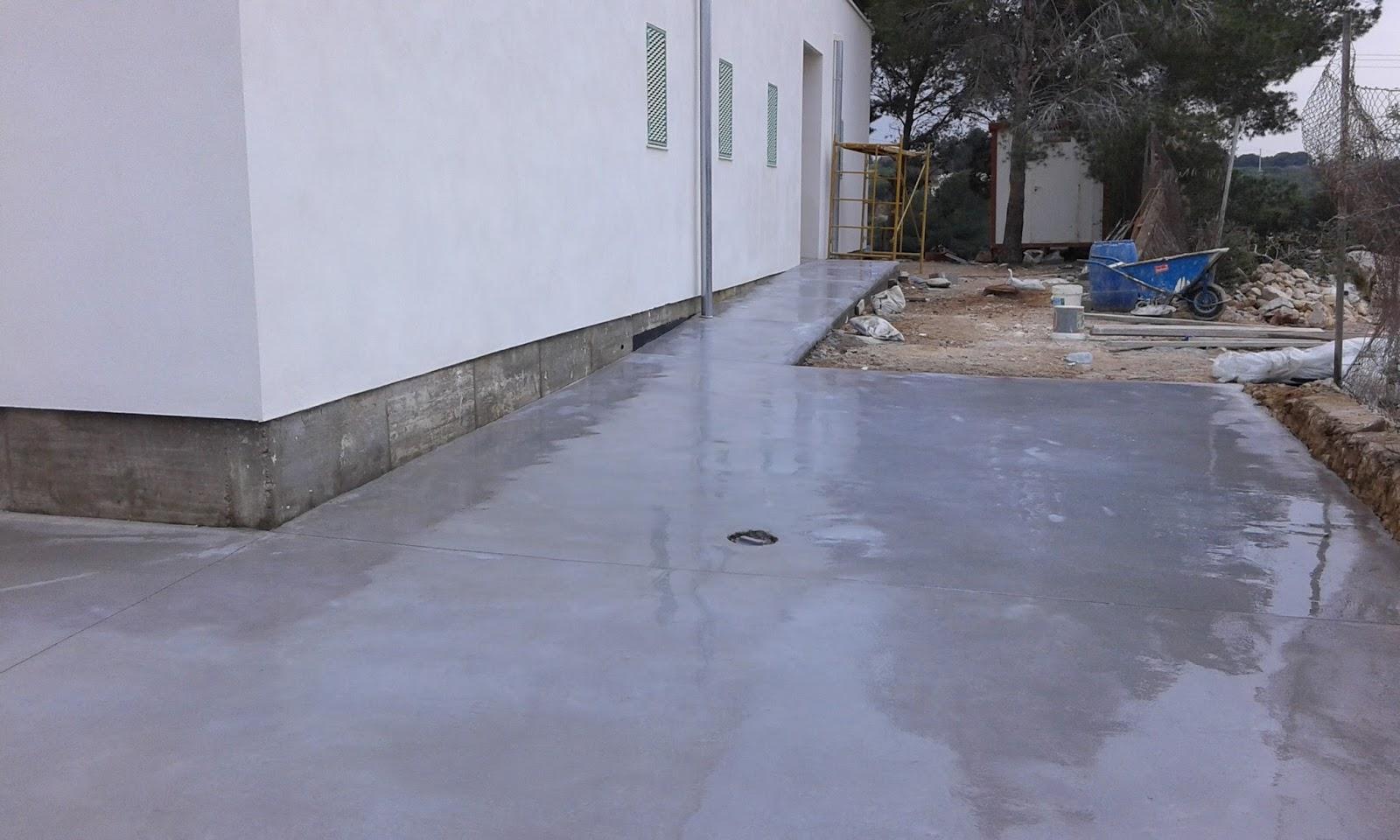 Pavimento continuo de hormig n liso en gris acero obra for Hormigon pulido blanco