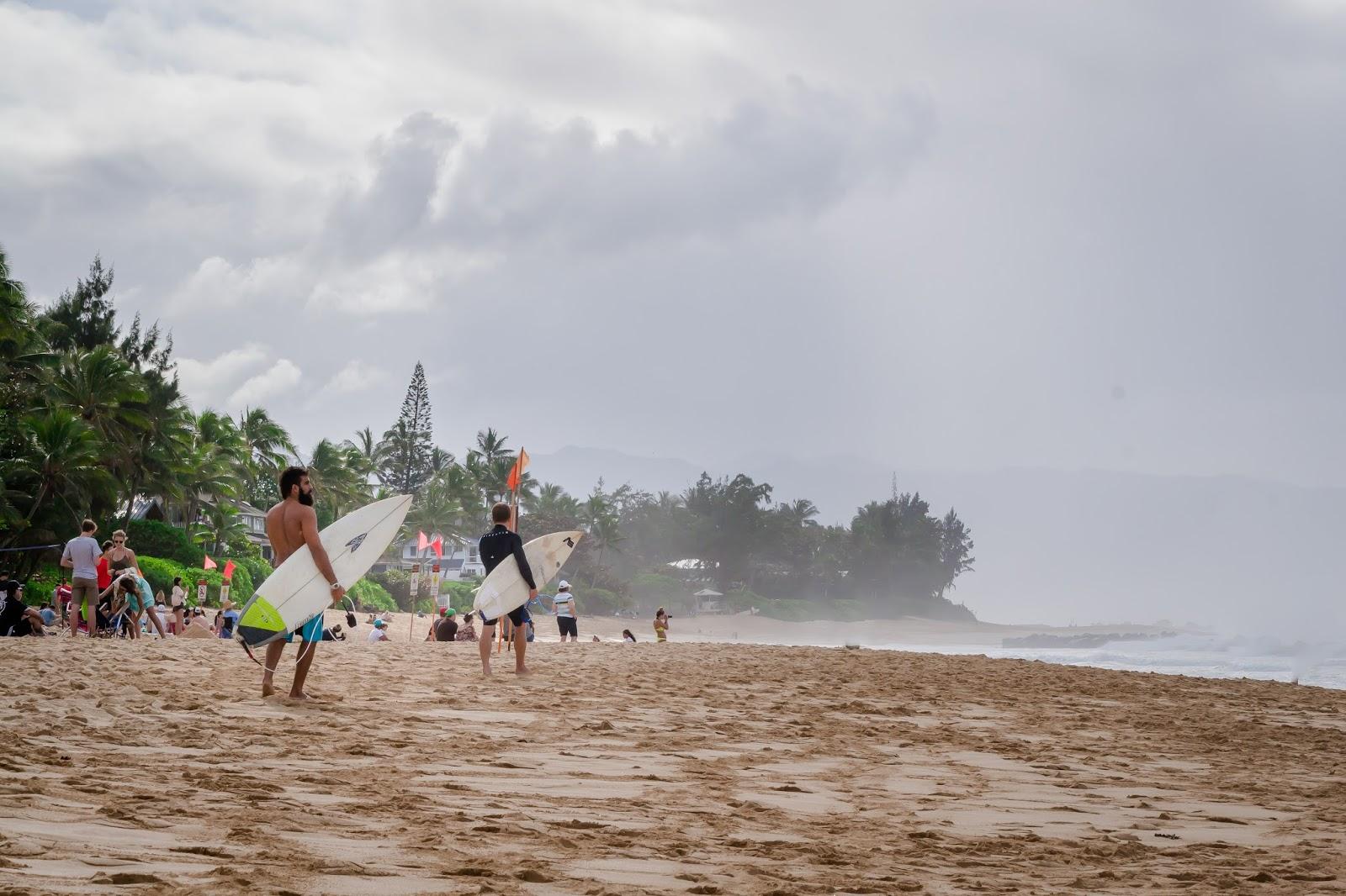 Surfers in Banzai Pipeline