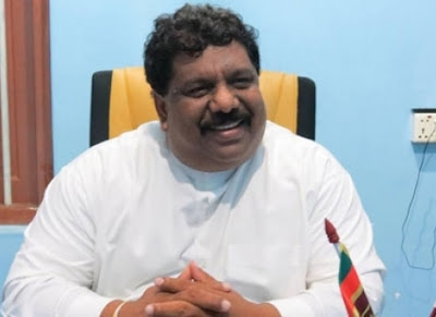 Minister D.V. Upul surrendered to Tissamaharama police today morning