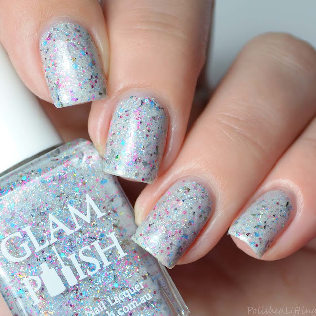 off white crelly nail polish with holo and flakies