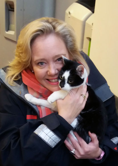 Black-and-white cat Dolly reunited with her owner Debs