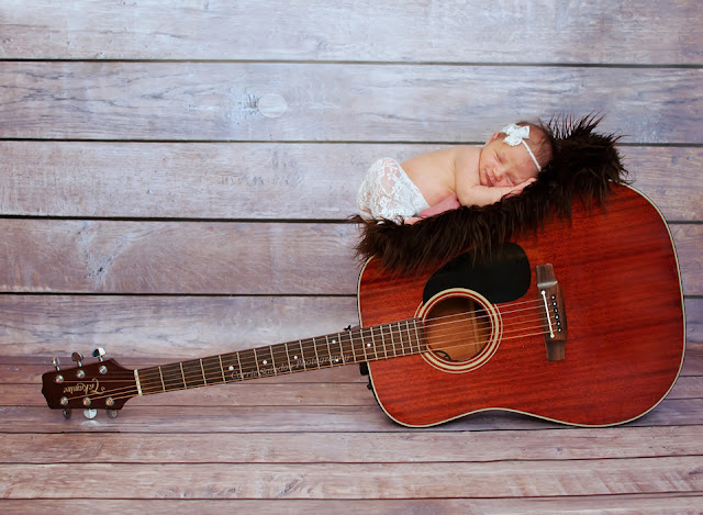 Newborn with guitar