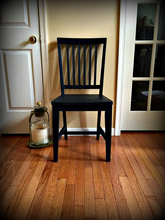 Black chair with matte finish.