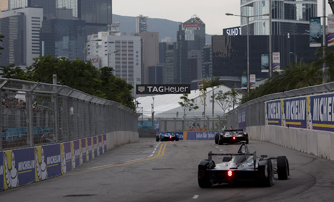 Formula E racing cars on a city circuit
