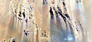 Imaginary castle walls yellow,abstract landscapes of deserts of Africa ,Abstract Naturalism,abstract photography deserts of Africa from the air,abstract surrealism,mirage fantasy forms of stone