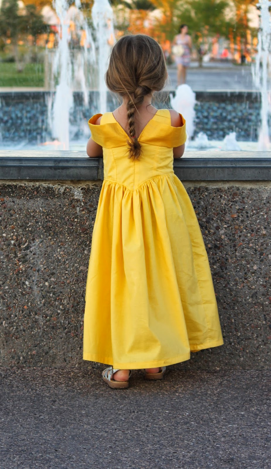 Little girl in yellow princess party dress