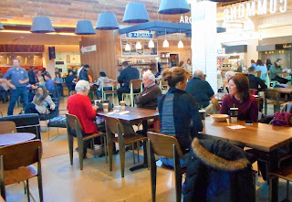 Flagship Commons Table and Chair Seating with Customers
