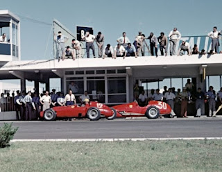 The pit lane at the Argentine Grand Prix of 1956, in which Musso, whose car is No 12, gained his only F1 win
