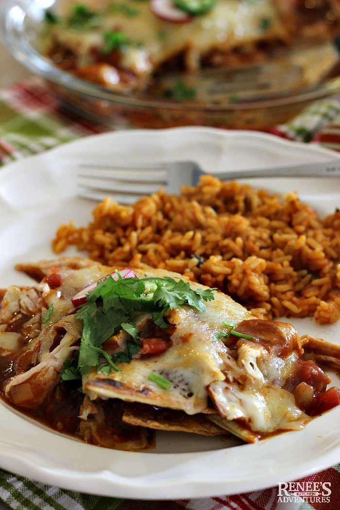 Easy Mexican Chilaquiles by Renee's Kitchen Adventures on a white plate with a fork and Mexican rice