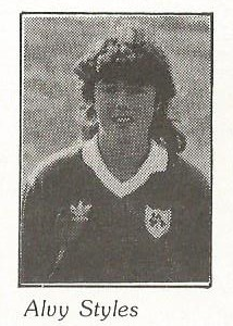 Black and white image of the head and upper torso of a smiling woman with dark, shoulder-length hair wearing a Republic of Ireland football jersey