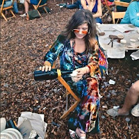 Janis Joplin drinking wine backstage at Woodstock