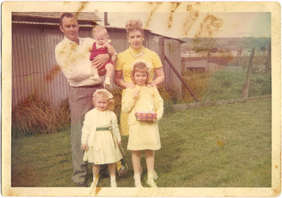 mother listed as Loretta with husband and three children posing in Easter outfits May 1967