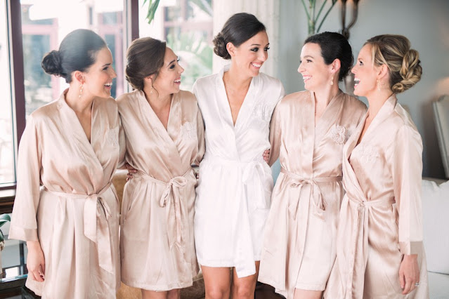 bride and bridesmaids in champagne robes