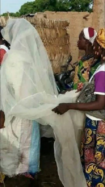 OMG!! What This Lady Was Seen Wearing on Her Wedding Day Will Totally Shock You (Photos)