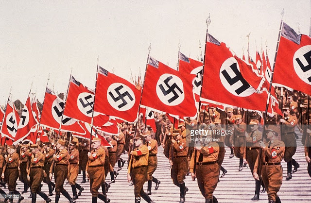 http://media.gettyimages.com/photos/the-entry-of-the-colours-or-swastikas-at-the-german-national-party-picture-id3431322