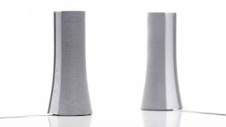 beautifully designed pair of stereo speakers with the same good