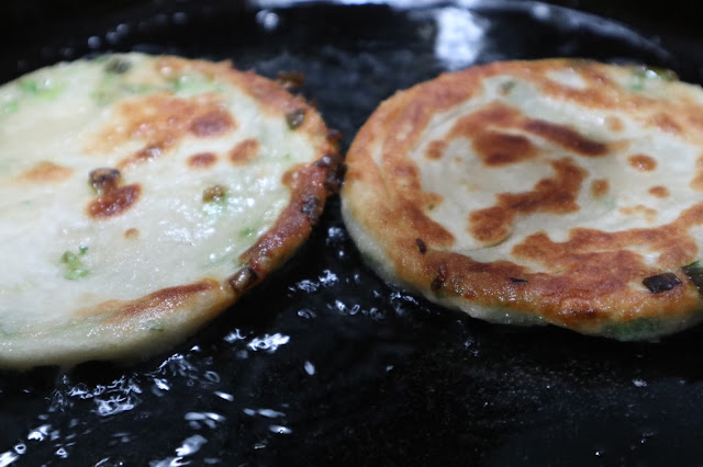 green onion cake on the cast iron pan