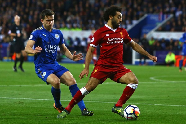 Liverpool's Egyptian midfielder Mohamed Salah (R) vies with Leicester City's English defender Ben Chilwell during the English Premier League football match between Leicester City and Liverpool at King Power Stadium in Leicester, central England on September 23, 2017..Liverpool won the game 3-2. / AFP PHOTO / Geoff CADDICK