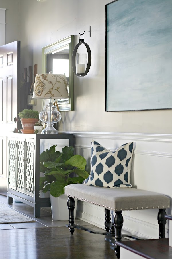 Bench and console table in foyer