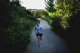 Better Living Fitness Nutrition Counselor Becca Addison on a recent run. Becca's background as a competitive runner is the reason she became interested in nutrition science. Becca provides nutrition counseling at Better Living Fitness Center in Ann Arbor, Michigan.