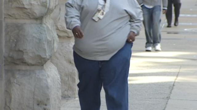 Obesity man walking