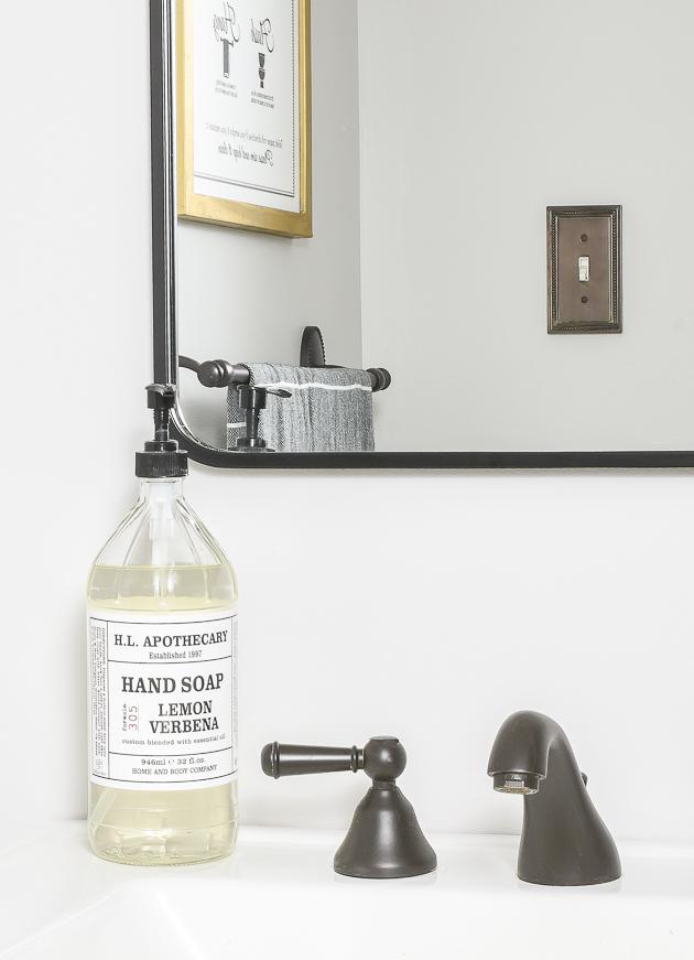 black mirror and faucet in vintage modern bathroom