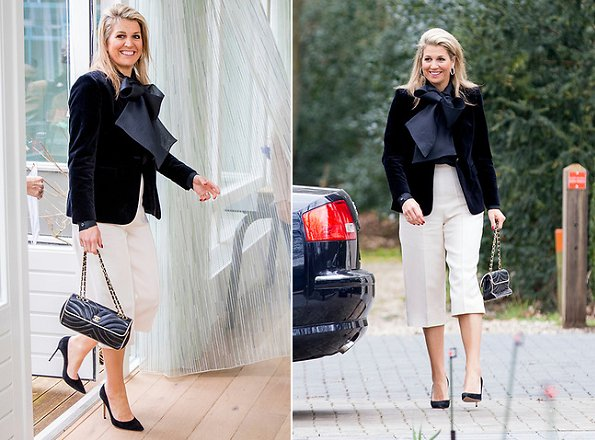 Dutch Queen Maxima wore a Natan velvet blazer and Natan silk blouse. Natan is a Belgian fashion house founded by Edouard Vermeulen