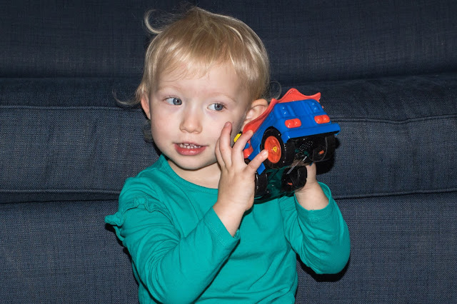 A preschooler listening to the sounds from the Herodrive Superman Mash Machine