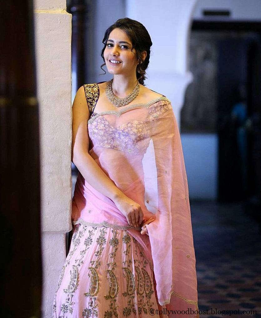 Rashi Khanna Stills In Traditional Pink Half Saree