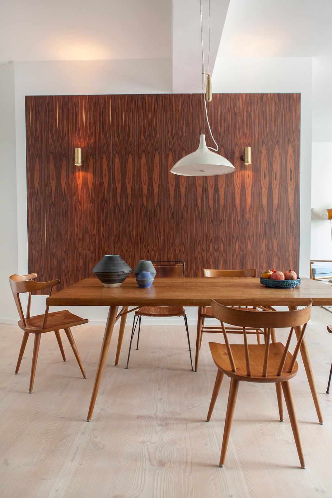 wood paneling in designer loft in berlin, mid century modern furniture,  pottery collection, interior design